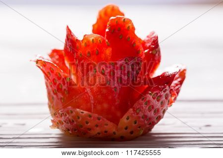 The Red Rose Which Is Cut Out From Ripe Strawberry On A Gleam