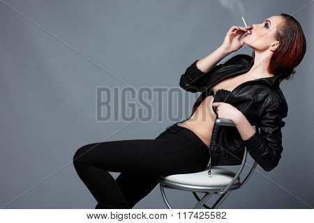 a portrait of beautiful sexual redheaded girl is in a black leather jacket, smoking a cigarette