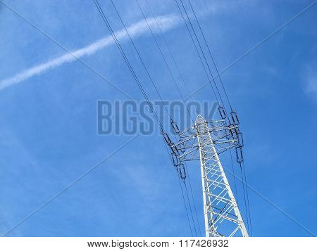 High Voltage Pylon Against Blue Sky