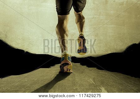 Strong Athletic Legs With Ripped Calf Muscle Of Young Sport Man Running On Grunge Asphalt Road