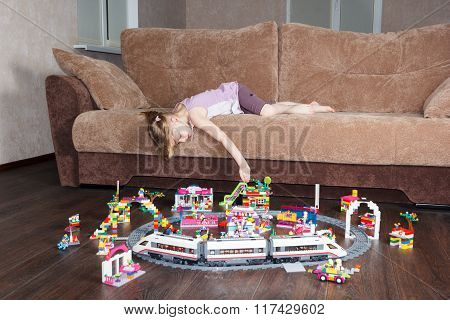 Little Girl Playing On A Couch