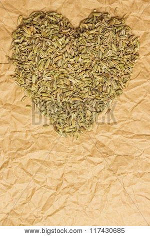 Fennel Dill Seeds Heart Shaped On Paper Surface