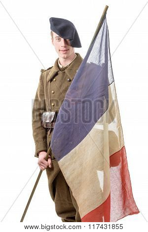 1940 French Soldier With A Flag Isolated On A White Background