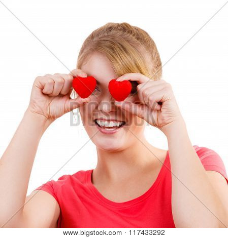 Funny Woman Holds Red Hearts Over Eyes