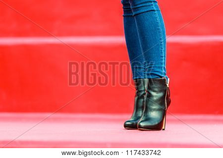 Woman Legs In Denim Pants Heels Boots Outdoor