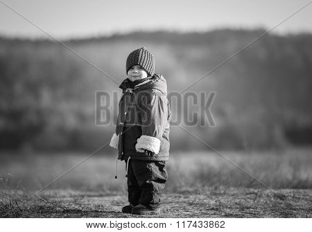 Young Happy Boy Playing Outdoor In Spring. Black And White