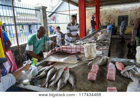 VICTORIA, SEYCHELLE - JULY 10: Sellers offer fresh fish and seafood in the Sir Selwyn Selwyn-Clarke Market on 10 July 2015 in Victoria, Mahé Island, Seychelle.