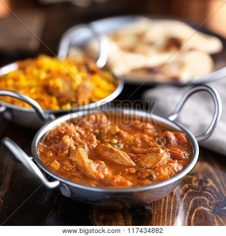 balti dish with butter chicken indian curry shot with selective focus