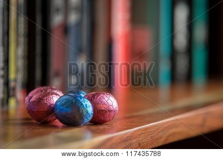 Chocolate Easter Eggs On Bookcase