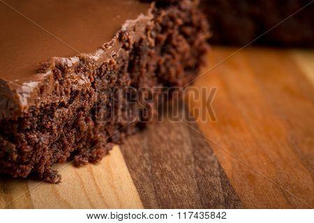 Chocolate Fudge Brownies On Wood Cutting Board