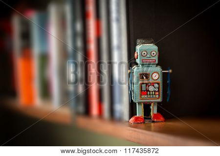 Vintage Tin Toy Robot On A Book Shelf