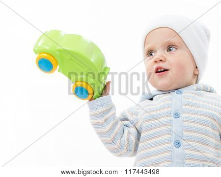 little child baby boy playing with car isolated on white studio shot