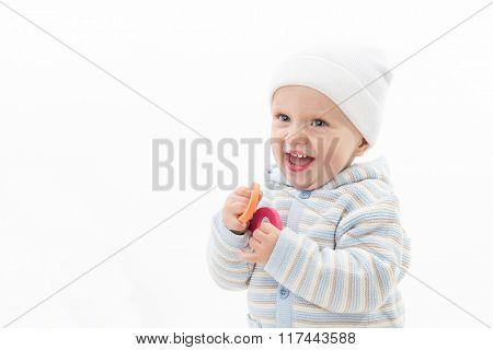 little child baby boy portrait face smiling happy cheerful laughing isolated on white studio shot warm clothing hat