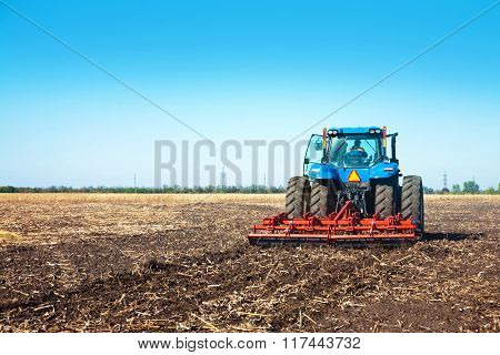 Blue Tractor In The Field