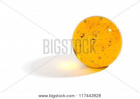 Yellow Glass Sphere Casting A Shadow