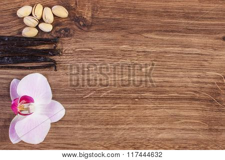 Pistachio Nuts, Blooming Orchid And Fragrant Vanilla Sticks, Cosmetic Ingredients, Copy Space For Te