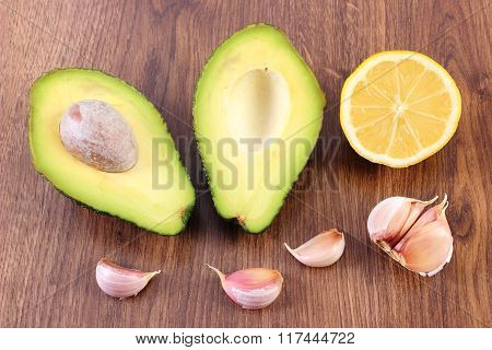 Avocado, Garlic And Lemon On Wooden Background, Ingredient Of Avocado Paste Or Guacamole, Healthy Fo