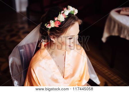 Beautiful Bride With Wreath Of Flowers In Her Hair Preparing. Wedding Day.