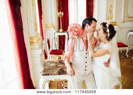 Happy Stylish Couple Lovely Hugging On Background Luxurious Interior Of The Amazing Castle.