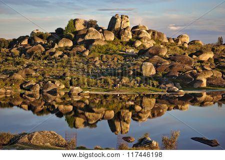 Reflection of big stones over a lake in Los Barruecos, Spain
