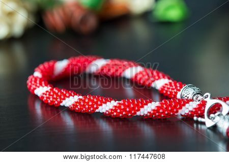 Fragment Of Red And White Beaded Necklace Close Up