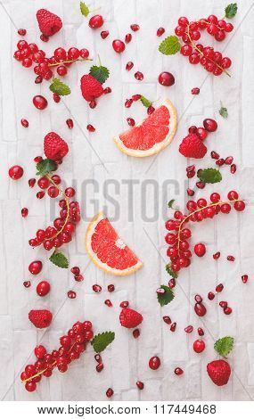 Fresh whole and sliced red fruits