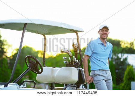 Young man in golf car outdoors