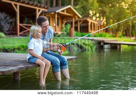 Dad and son fishing on the lake