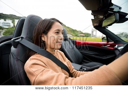 Woman driving a convertible sports car