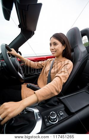 Girl driving convertible