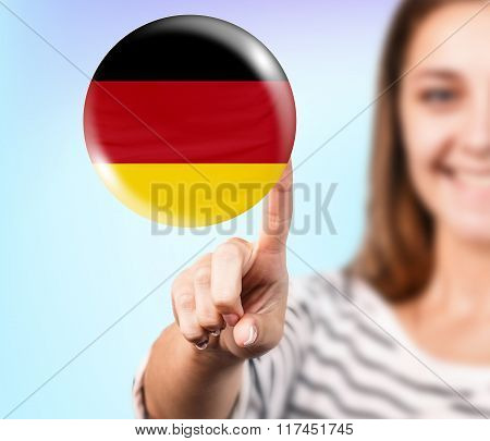 Woman point on the bubble with german flag