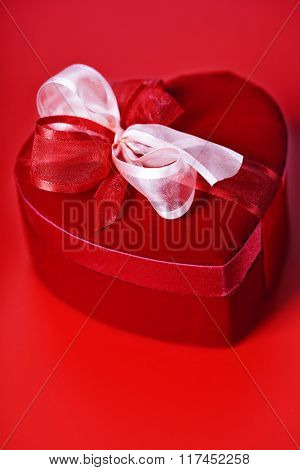 red love heart gift box over red
