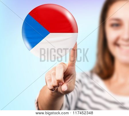 Woman point on the bubble with czech flag