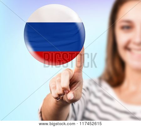 Woman point on the bubble with russian flag