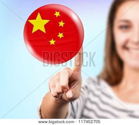 Woman point on the bubble with chinese flag