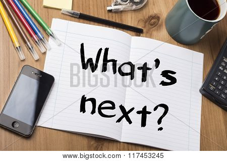 What's Next? - Note Pad With Text On Wooden Table