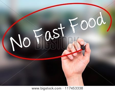 Man Hand Writing No Fast Food With Black Marker On Visual Screen.