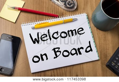 Welcome On Board - Note Pad With Text On Wooden Table