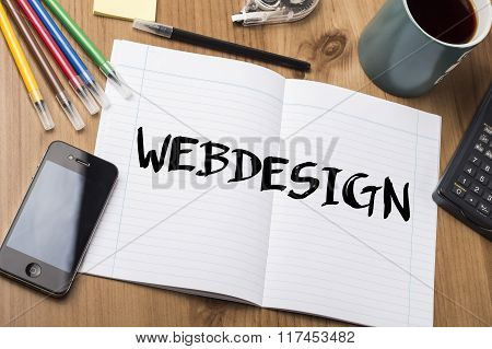 Webdesign - Note Pad With Text On Wooden Table