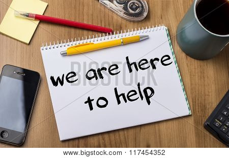 We Are Here To Help - Note Pad With Text On Wooden Table