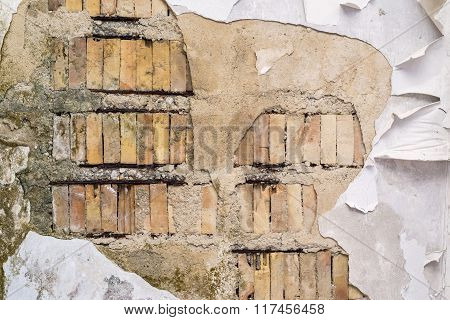 Old Brick Surface With The Destroyed Plaster