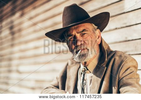 Senior Man Smoking A Cigarette With A Pensive Look