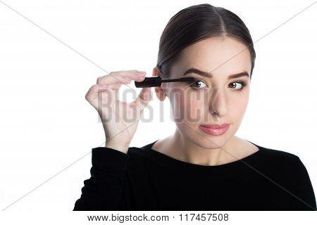 Beautiful young woman applied mascara