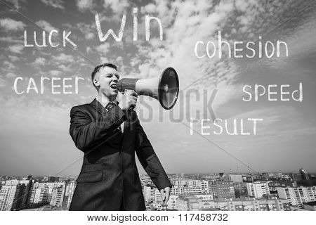 Businessman on the roof with megaphone