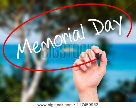 Man Hand Writing Memorial Day With Black Marker On Visual Screen.