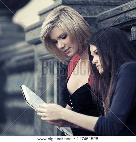 Two young female students on campus