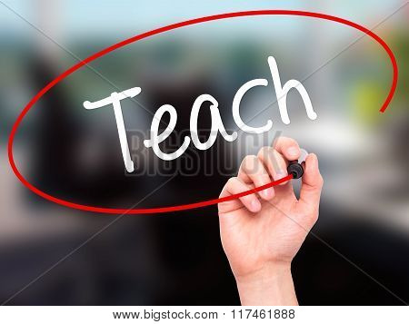Man Hand Writing Teach With Black Marker On Visual Screen.