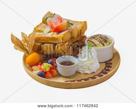 Isolated On White Background With Clipping Path Of Selective Focus Of Honey Toast On Wood Plate With