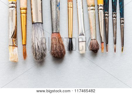 Used different size paint brushes. retro style wooden paintbrush texture. top view, soft focus, clos