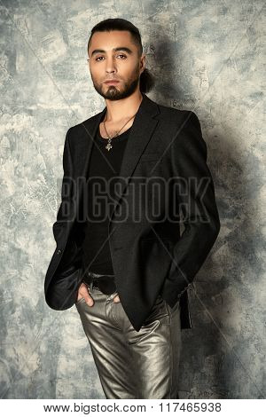Fashion shot of a stylish handsome man. Hairstyle.